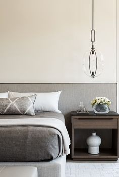 Grey, minimal, masculine bedroom design by Matthew Leverone | Photo by Joe Fletcher