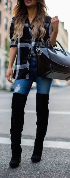 Plaid shirt with over the knee boots.