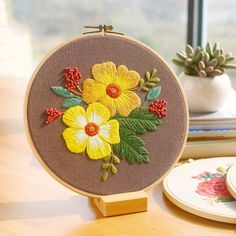 Product Description : DIY Chinese Flower Embroidery Kit with Hoop Printed Flower Needlework Cross-Stitching Set Swing Art Craft Wall Home Decor Quantity:1 piece Package list: 1 Set ( Fabric Ribbon*1, Thread*1, Drawings*1, Needle*2) Hoop size:20*20cm     embroidery kit, unfinished, need sewing by yourself.
