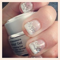 Gel nails, yet again. White tip, silver sparkles.