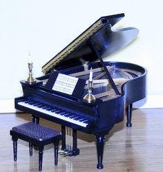 I like this piano http://pinterest.com/cameronpiano