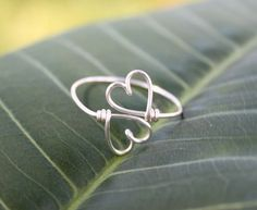 20 Gauge Wire *Wal-mart or Michaels Pliers Cut your wire about 3 1/2 to 4 inches long. Make a V Shape your wire like a heart. lift up the middle and using my pliers, twist the middle over itself. Like the picture above. The wire is very forgiving so you can shape it pretty easily. Then on one side, using pliers, curled it up.
