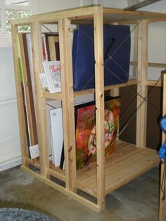 I built this canvas storage rack for myself using cheap IKEA shelving, adapting some that I already had and then purchasing a few more supports. They are essentially sideways bookshelves that are t…