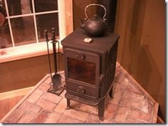 The Morso 1410 Squirrel is a great wood burning stove for your cabin.  This little stove is incredibly efficient and clean burning.  Here's a little review I did.