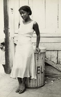 """""""Woman in a Courtyard"""", 1933. Photo by Walker Evans. I LOVE her expression! So pretty!"""