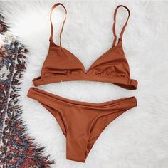 Rust minimalist bikini top and cheeky bikini bottoms are selling out quick! Click link in bio to grab yours before they're gone ✨ #lovestreetapparel