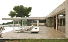 A far cry from the whitewashed buildings of Mykonos, this vacation home on the Aegean island of Skiathos will make any modern design fan go Greek. Stone walls, a pine tree exploding out of a deep overhang, iroko decking, outdoor rooms, a glassy swimming pool, and endless views of the sea make this home a paragon of indoor-outdoor living. Photo by Andrea Wyner.