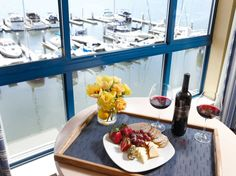 Strawberries & Wine with a view of the docks at The Waterfront Hotel in Oakland - A Joie de Vivre Hotel