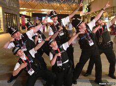 Police officers struck a Usain Bolt pose