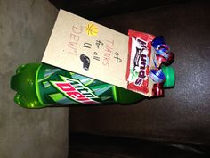 """Thank you gift for Coach: Mounds Fun Sized Candy Bar and a bottle of Mt. Dew.  """"Mounds of Thanks for all u Dew!""""  Note card purchased from Michaels Craft Store; used small clear elastic band (the kind used to make the rubber band bracelets) to secure card to bottle.  Embellished with curling ribbon."""