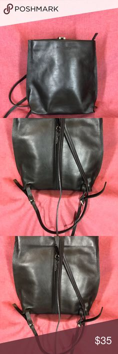 Black leather backpack Beautiful black leather Kenneth Cole backpack, can be worn with anything dressy or casual. Plenty of room but not oversized. Kenneth Cole Bags Backpacks