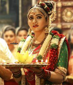 South Indian bride. Gold Indian bridal jewelry.Temple jewelry. Jhumkis.Red silk kanchipuram sari with contrast green blouse.Braid with fresh jasmine flowers. Tamil bride. Telugu bride. Kannada bride. Hindu bride. Malayalee bride.Kerala bride.South Indian wedding. andal. Anushka Shetty.