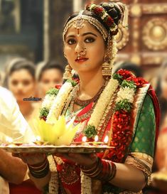 South Indian bride. Gold Indian bridal jewelry.Temple jewelry. Jhumkis.Red silk kanchipuram sari with contrast green blouse.Braid with fresh jasmine flowers. Tamil bride. Telugu bride. Kannada bride. Hindu bride. Malayalee bride.Kerala bride.South Indian wedding. andal. Anushka Shetty.