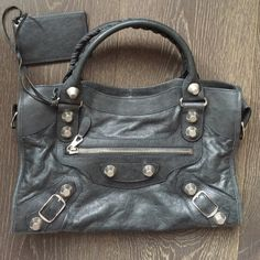 Rare charcoal grey Balenciaga bag Limited edition color-gorgeous charcoal. A statement and classic piece. Can be worn under arm as well with detachable strap included. Shown as a tote. Balenciaga Bags Shoulder Bags