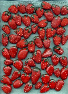 painted strawberry rocks in your berry patch keep the birds away from the real fruit
