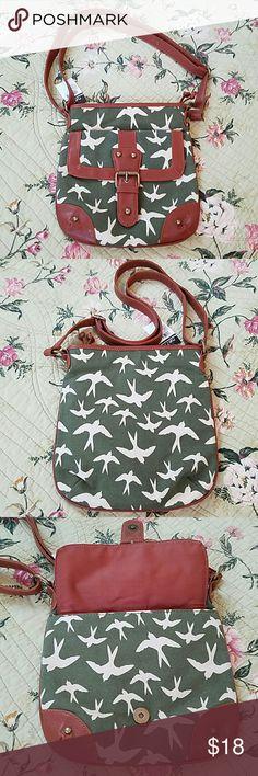"NWT Rue 21 Shoulder/ Crossbody Bag Adorable New With Tags Rue 21 Shoulder/ Crossbody Bag. Adjustable Shoulder Strap. Measurements Approximately 9 1/2"" W x 10"" H. Interior has 1 Zipper Compartment and 2 Slip Pockets. Full Zipper Closure. Exterior has Front Snap Closure Pocket. Rue 21 Bags"