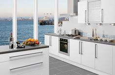 I like the fact that you can look out at the water as you cook.  I do wish the stove was centered on the window.