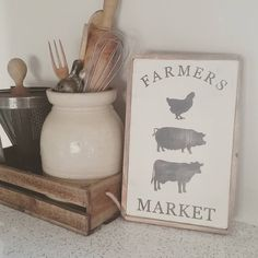 There is nothing cuter than vintage wooden utensils and farm signs. Bought on Etsy