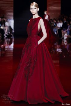 Above, heavily embellished long sleeve wedding dress with matching veil. Below, sleeveless ruby ball gown. Insane color!