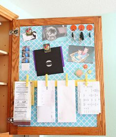 Magnetic board inside kitchen cabinet - organize coupons here.  ~ 20 Super Smart Ways to Organize Your Kitchen via Brit + Co.