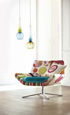ELITE DECOR: my husband would love this 60's chair.  Like the two pendants