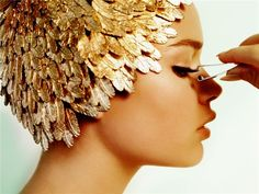 Gold metallic feather cap.