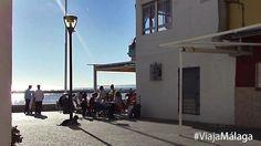 Barrio de Pedregalejo, su paseo marítimo y terraza de uno de sus muchos bares.