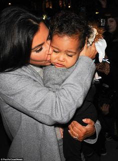 A kiss for my baby: Kim shows her affection for baby North earlier on during an outing in New York City