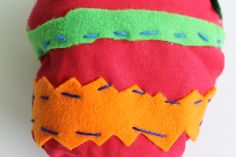 Eggy by Seamus  age 8 Artspark kids http://artspark-studio.com.au/ fabric, felt, buttons.