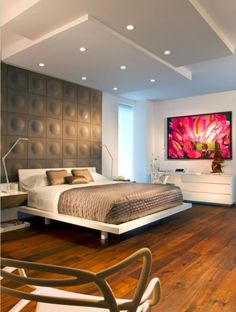 sleek bedroom w/ a punch of pink - I really like the texture of the wall and the signature piece of art