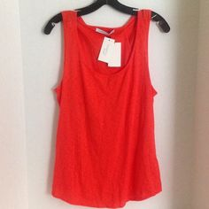 Twenty Muscle Tank W/Back Criss-Cross - Size L This is a great tank for the summer.  Style# AVOC-009-NM.  100% Cotton. Purchased at Neiman Marcus.  Made in Canada. Happy Poshing! Twenty Tops Tank Tops