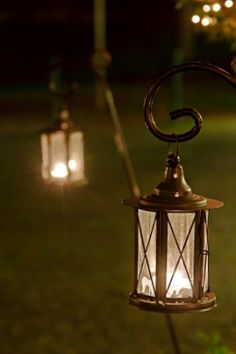 Patio Candle Lanterns ~ nice ambience on stakes or hooks in a large container pot on the patio