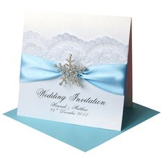 stunning vintage lace snowflake wedding invitation. Possibility but with navy blue and an ivory pearl paper, or navy blue paper and a ivory satin ribbon