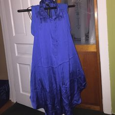 BLUE TUNIC  BLUE H&M TUNIC NEVER WORN FRONT IS SILKY AN SHEER IN THE BACK, BUTTONS IN THE FRONT HALFWAY, HAS SIDE POCKETS 100% POLYESTER SIZE12 H&M Tops Tunics