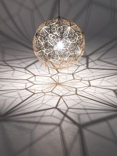 Etch Web Pendant Lamp by Tom DixonThe lamp is a vast 65cm wide shade with an unusual open structure, designed to cast.