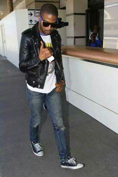 Kid Cudi wears Super Flat Top Suede Sunglasses, Saint Laurent Leather Biker Jacket, Pink Floyd Tee, and Converse Sneakers at LAX Airport Dior Kids, Jeans And Converse, Kid Cudi, Saint Laurent Paris, Vintage Tees, Chuck Taylors, Denim Jeans, Bomber Jacket, Menswear