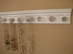 Necklace organizer. This jewelry hanger has 7  knobs by Gotahangup, $39.00