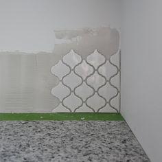 Close up of tile applied in corner of backsplash