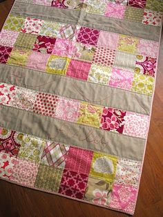 straight-line quilting, just two lines per row of piecing. hand embroidery. neat!
