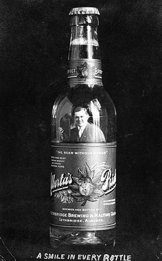 "Photograph is of an early advertisement for the Lethbridge Brewing and Malting Company. It depicts Fritz Sick inside a bottle of Alberta's Pride Beer. Caption below the bottle reads, "" A smile in every bottle"". #Edwardian #beer #advertising #vintage #Canada"