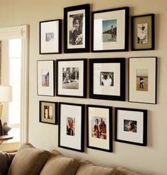 Photo wall using B&W and Color photo's all in same frame going down basement stairs of new house