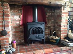 Jotul F3 woodstove in bressumer fireplace #jotul#woodstove