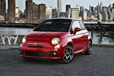 2013 Fiat 500 Hatchback Front Quarter - Courtesy of Fiat Group Automobiles S.p.A. (Red)