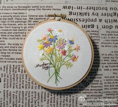 Embroidered floral bouquet.  On Duitang website, which I wish I could read…… 绣花…_来自设计的幸福生活的图片分享-堆糖网