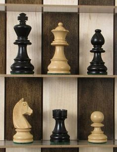 """Straight Up Chess boards are not only a unique decoration for the wall but they are designed to play a casual game of chess. The chess pieces rest on narrow acrylic shelves, as you make your moves around the Straight Up Chess board. Markers are included for """"Last Move"""" and """"Check""""."""