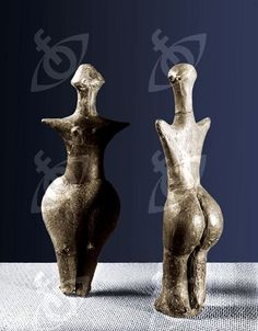 Female figurines. Country of Origin: Moravia. Culture: Neolithic Place of Origin: Strelice. Material/ Size: Baked clay H=21 and 22cm. Credit Line: Werner Forman Archive/ Moravian Museum, Brno