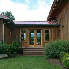 rustic exterior by Menter Architects LLC