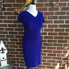 Dress Very pretty cobalt blue pleated dress, with tags never worn! Has a fitted design to it. This dress is BEAUTIFUL AND VERY FITTED, great for those holiday parties. London Times Dresses