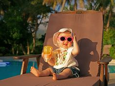 """Vacations are the best! ...I don't know what they fill this sippy cup up with, but it just tastes better under the palm trees, layin' by the pool."""