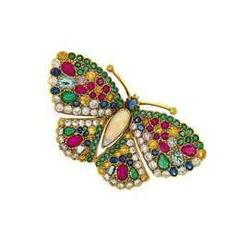 An 18ct. gold, diamond, coloured diamond and gem butterfly brooch  The pear shaped opal body to brilliant-cut diamond, yellow and faint pink diamond, vari-cut emerald, ruby and sapphire and pale blue gem wings, the cabochon sapphire head and eyes to twin antennae with yellow diamond single stone terminals